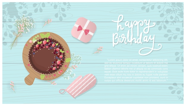 Chocolate and berries birthday cake with gift box, cooking gloves and flowers