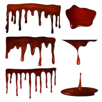 Шоколадные капли или растопленная шоколадная помадка, клякса и брызги темного шоколада.