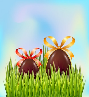 Chocolate easter eggs hidden in green grass on sky background