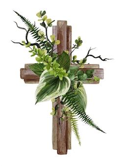 花と葉で飾られたキリスト教の木製の十字架