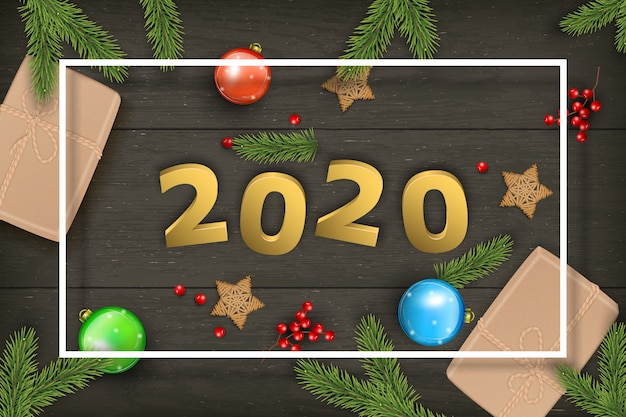 Christmas and 2020 new year  on dark wooden .