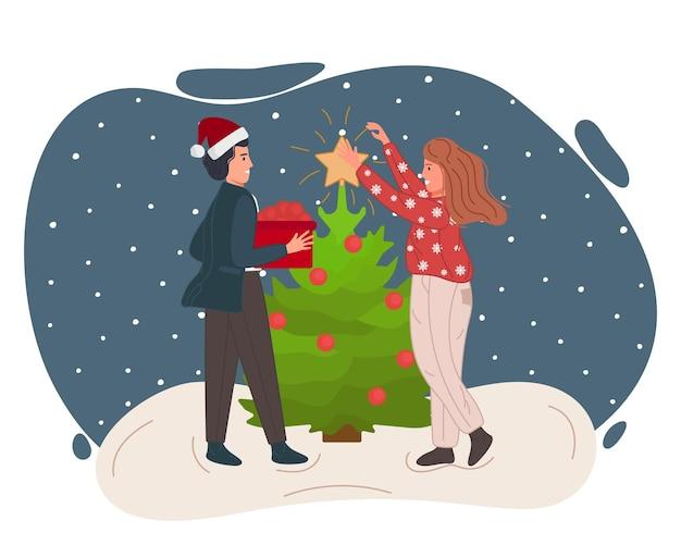 女性と男性を祝うクリスマスと新年あけましておめでとうございますの人々は一緒にクリスマスツリーを飾ります