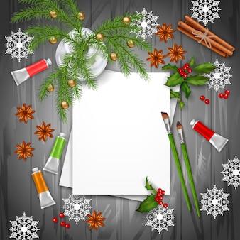 Рождество и новогодний фон с чистыми листами бумаги, еловыми ветками, красками и кистями
