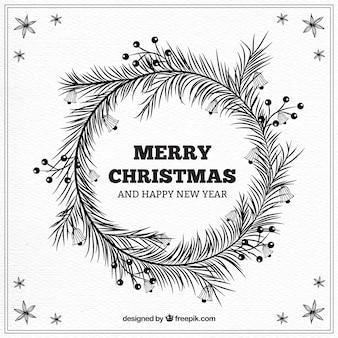 クリスマスと手描きの葉を使用して新しい年の背景