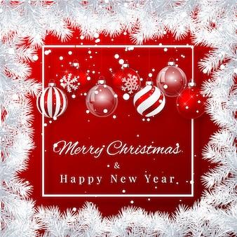 クリスマスと新年の背景に赤いクリスマスボール、モミの枝とクリスマスの雪