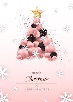 クリスマスと新年のカード。ピンクの背景にクリスマスボールなどのお祭り要素で作られた豪華なクリスマスツリー。