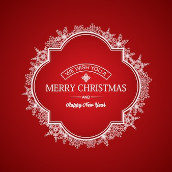 フレームに挨拶の碑文と赤に白い雪片が付いたクリスマスと年賀状