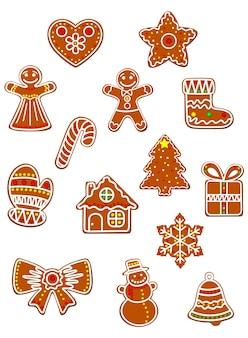 かわいいジンジャーブレッドマン、弓、ギフトボックスと靴下、星とキャンディーで飾られた休日の装飾のための色付きの砂糖釉薬のクリスマスと新年のコレクション