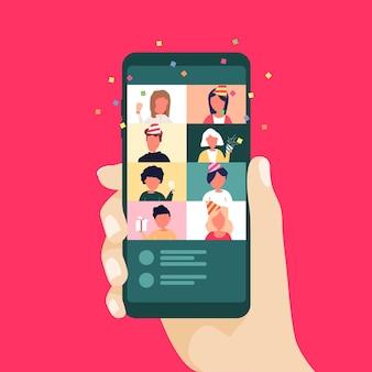 휴대 전화를 사용하여 크리스마스와 새해 온라인 축하. 화상 통화로 온라인 파티.