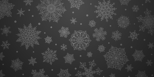 Christmas background of big and small complex snowflakes in black colors