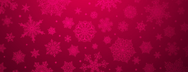 Christmas background of big and small complex snowflakes in crimson colors