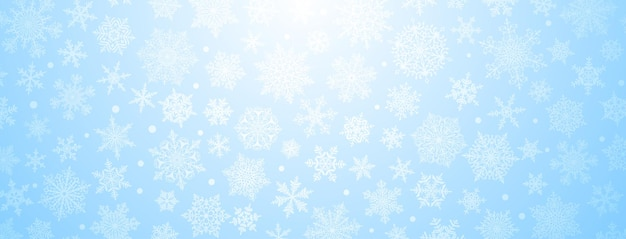 Christmas background of big and small complex snowflakes in light blue colors