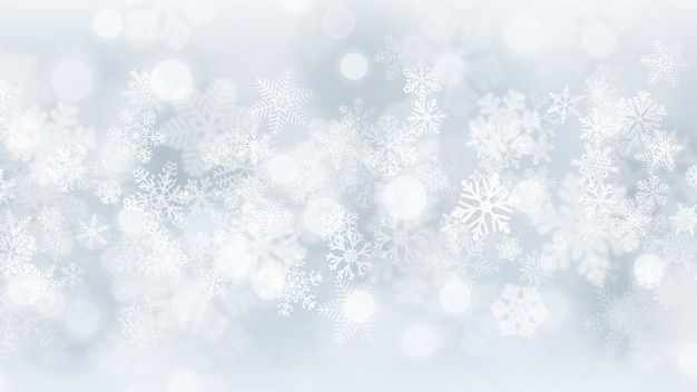 Christmas background of big and small snowflakes with bokeh effect, in white and gray colors