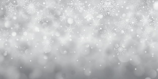 Christmas background of complex big and small falling snowflakes in gray colors with bokeh effect