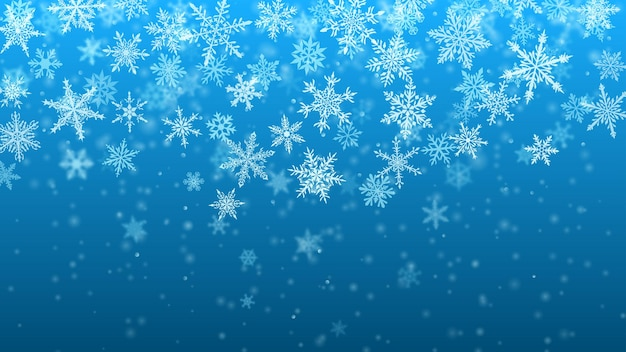 Christmas background of complex blurred and clear falling snowflakes in light blue colors with bokeh effect