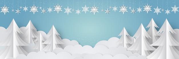 冬に降る雪と松の木と雪の結晶のクリスマスの背景デザイン