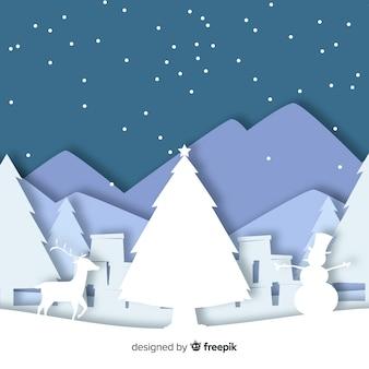 紙のカットスタイルでクリスマスの背景