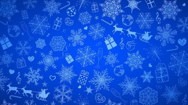 Новогодний фон из больших и маленьких снежинок и различных рождественских символов, белый на синем