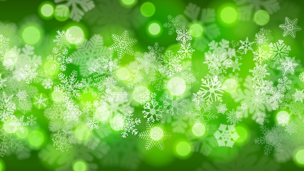 녹색 색상의 보케 효과가 있는 크고 작은 눈송이의 크리스마스 배경