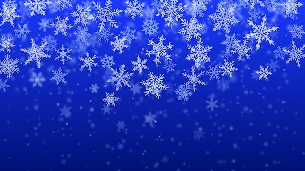 보케 효과가 있는 파란색으로 복잡하고 흐릿하고 맑은 떨어지는 눈송이의 크리스마스 배경