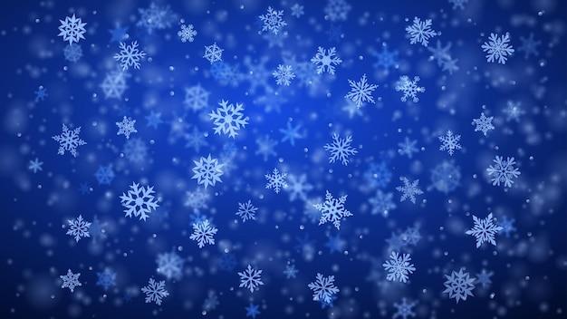 Новогодний фон из сложных размытых и четких падающих снежинок в синих тонах с эффектом боке