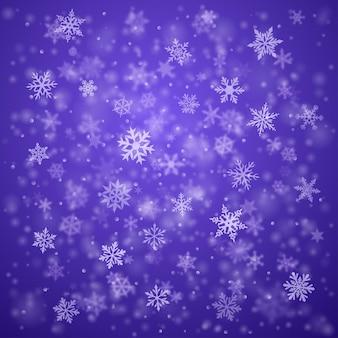 ボケ効果のある青い色の複雑なぼやけてはっきりとした雪の結晶のクリスマス背景