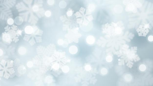 グレアとボケ効果のある焦点がぼけた雪片のクリスマスの背景、水色