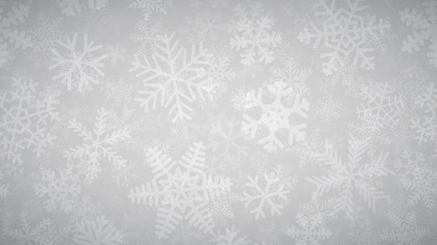 Новогодний фон из многих слоев снежинок разной формы, размера и прозрачности. белый на светло-сером.