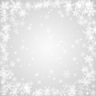 Новогодний фон из снежинок, расположенных по кругу, в серых тонах