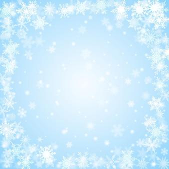 Новогодний фон из снежинок, расположенных по кругу, в голубых тонах