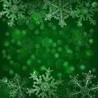 雪片のクリスマスの背景、緑色で
