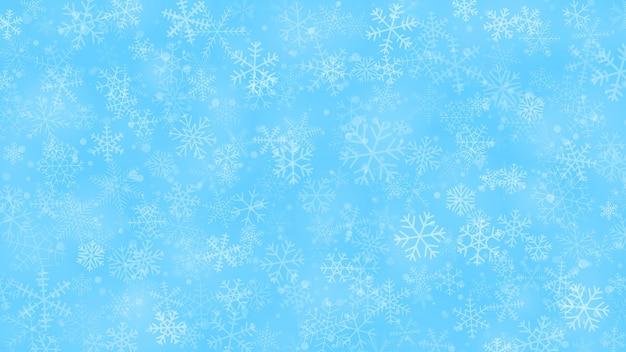 Новогодний фон из снежинок разной формы, размера и прозрачности в голубых тонах
