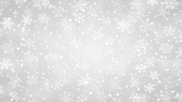 さまざまな形の雪の結晶のクリスマス背景。