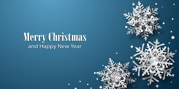 Christmas background of paper snowflakes with soft shadows, white on blue background