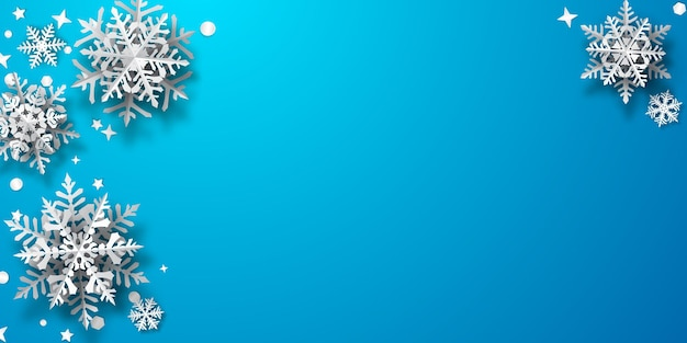 Christmas background of paper snowflakes with soft shadows, white on light blue background