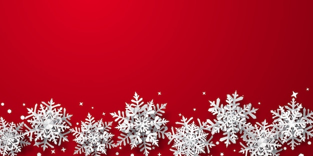 Christmas background of paper snowflakes with soft shadows, white on red background