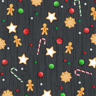 クリスマスの背景、木製の黒いテーブルのお菓子。