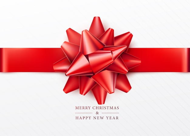Christmas background. white gift box with red bow and ribbon. top view. greeting text sign. merry xmas and happy new year.