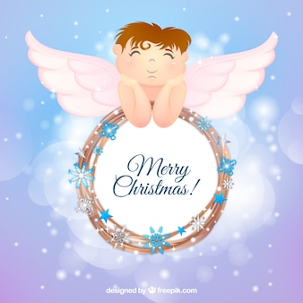 Christmas background with an angel and a wreath