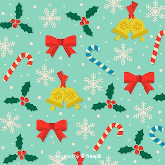 Christmas background with candies ribbons and bells
