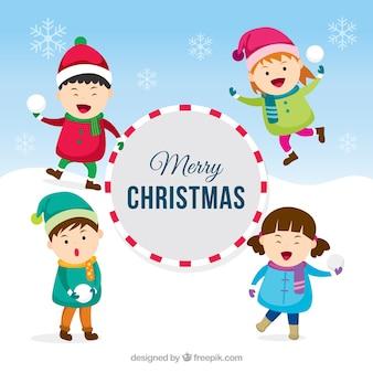 かわいい子供と雪だるまをするクリスマスの背景