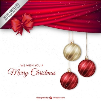 Christmas background with elegant baubles and red ribbon