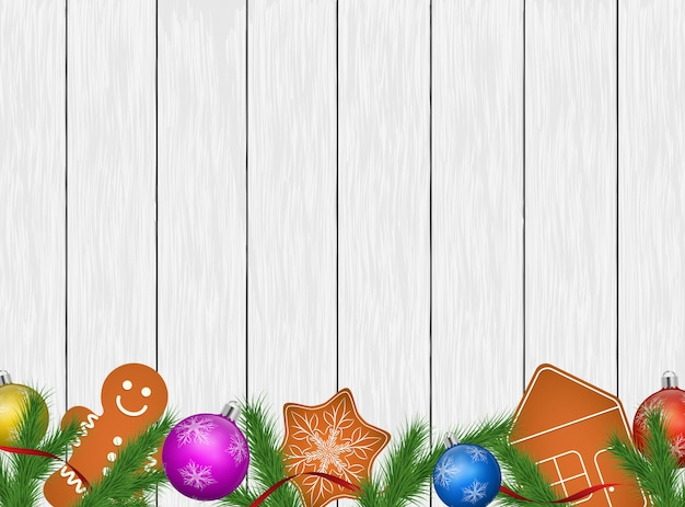 Christmas background with festive decorations on wood planks.