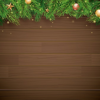 Christmas background with fir branch on brown wood and space for text