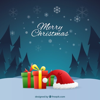 クリスマスの背景に贈り物とサンタクロースキャップ
