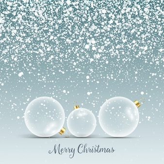 Christmas background with glass baubles in snow