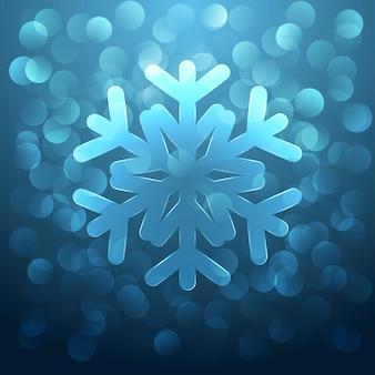 ガラスの雪の結晶と青のまぶしさのクリスマスの背景