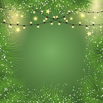 Christmas background with lights and fir tree branches