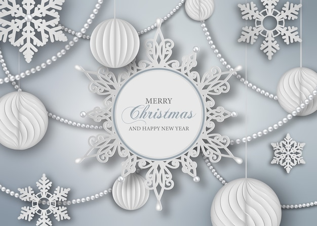 紙の雪とボールとクリスマスの背景