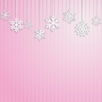 Christmas background with several hanging snowflakes on pink striped background
